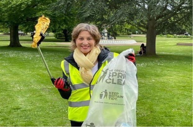 Minister Pow picking litter