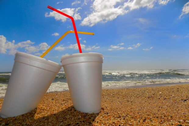 Polystyrene cups littered on a beach